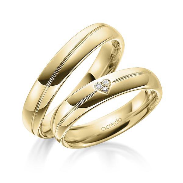 Bagues en or jaune et rainure centrale avec diamant en coeur