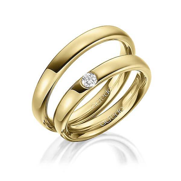Alliances en or jaune et diamants
