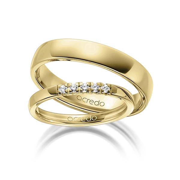 Couple de bagues de mariage en or jaune avec diamants incrustés