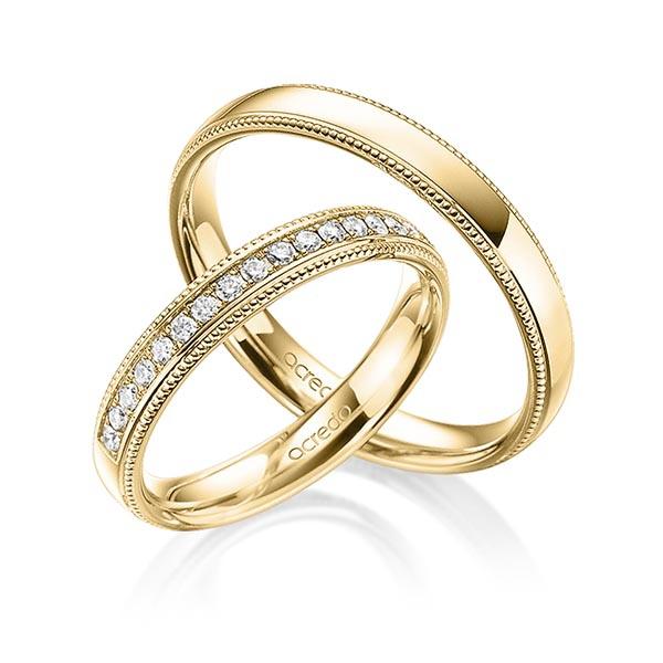 Alliances en or jaunes avec diamants et finition millegrains
