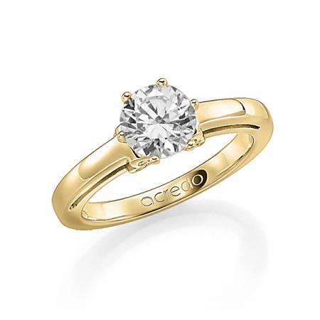 Bague de fiançailles avec diamant rond et coeurs formant le serti