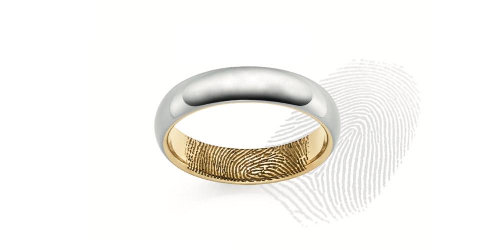Gravure des empreintes digitales sur les bagues de mariage